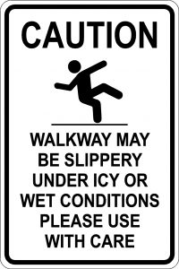 Caution. Walkway may be slippery under icy or wet conditions. Please use with care Sign. Black Font on White Background