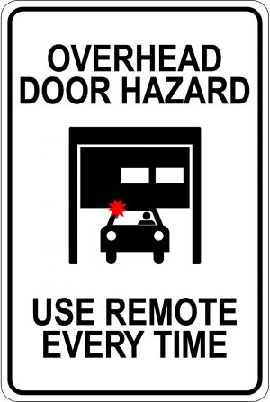 Overhead Door Hazard. Use Remote Every Time Sign