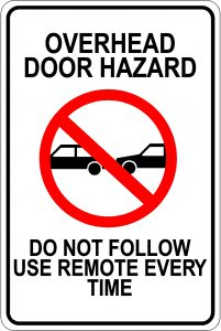 Overhead Door Hazard. Do Not Follow. Use Remote Every Time Sign