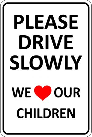 Please Drive Slowly. We Love our Children sign