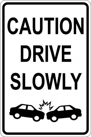 Caution Drive Slowly Sign - White Background