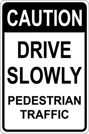 Caution Drive Slowly Pedestrian Traffic Sign. Black Font, White Background